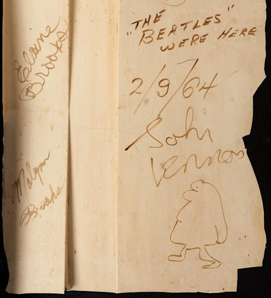 This undated photo provided by Heritage Auctions shows autographs by The Beatles on a 4-foot-by-2-foot section of a backdrop wall from the New York theater where The Ed Sullivan Show theater took place. Between the group's sets during their historic television appearance Feb. 9, 1964, the four Beatles penned their autographs and drew caricatures at the urging of a stagehand. Now that artifact, believed to be the largest Beatles autograph, is being sold on April 26, 2014, by Heritage Auctions in New York where it could realize $800,000 to $1 million. (AP Photo/Heritage Auctions)