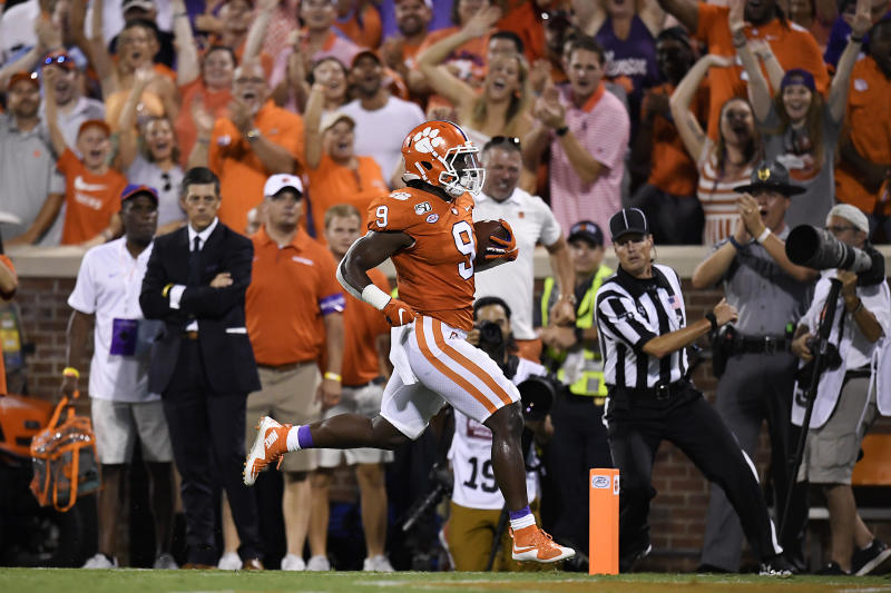 CLEMSON, SOUTH CAROLINA - AUGUST 29: Running back Travis Etienne #9 of the Clemson Tigers rushes for a 90-yard touchdown during the first quarter of the Tigers' football game against the Georgia Tech Yellow Jackets at Memorial Stadium on August 29, 2019 in Clemson, South Carolina. (Photo by Mike Comer/Getty Images)