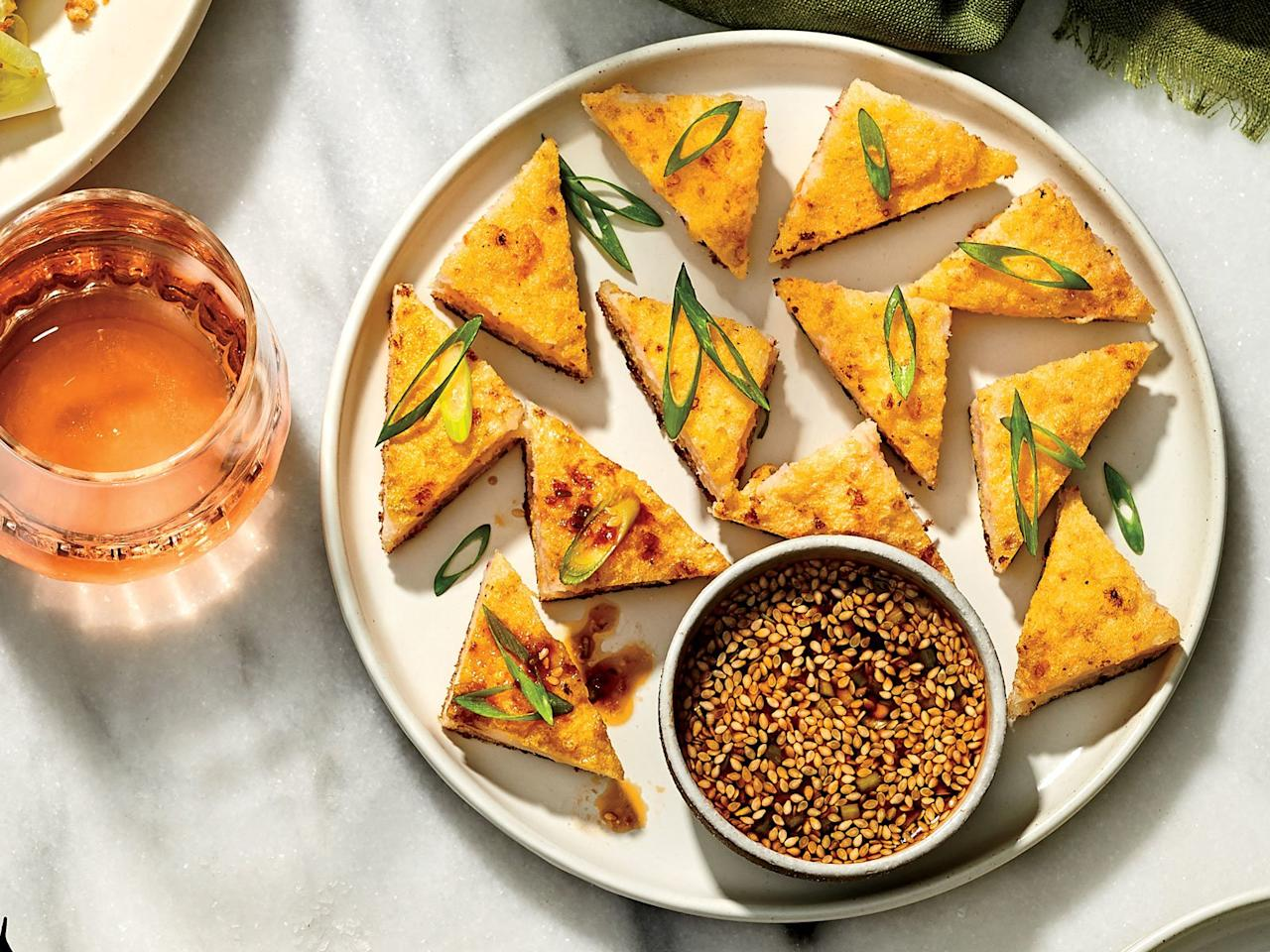 """<p>The secret to this semi-traditional dim sum favorite is a butter-studded shrimp mousse that comes together quickly in a food processor with just five ingredients.</p> <p> <a href=""""https://www.foodandwine.com/recipes/shrimp-toasts-scallion-chile-sauce"""">Go to recipe</a></p>"""