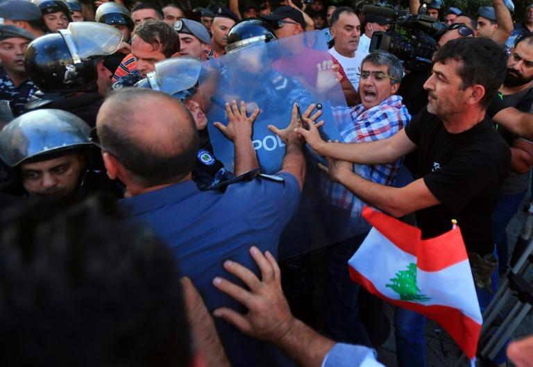 Lebanese retired military and security personnel have clashed with police ahead of a vote in parliament to pass a 2019 austerity budget which they say will cut their pensions