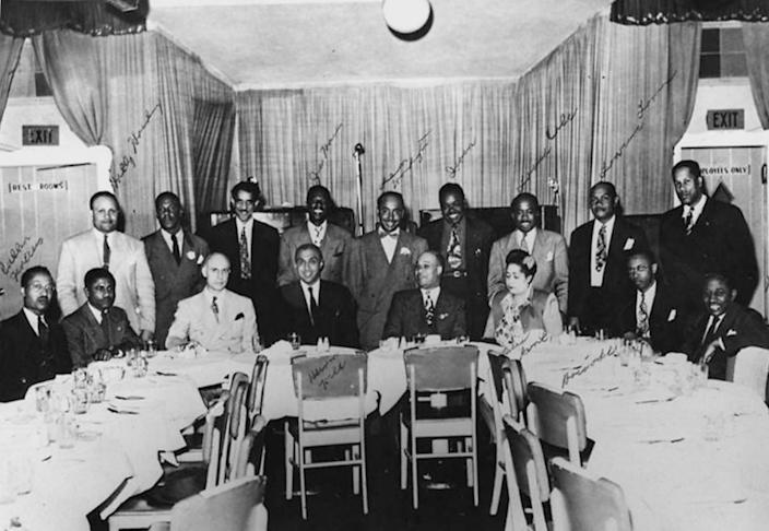 Newspaper journalists together for a meeting. Identified are: (standing l to r) Halley Harding,