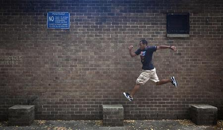Rashaad Gomez practises parkour in a park in New York