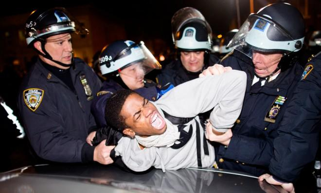 Police arrest a demonstrator during a march after a vigil held for Kimani Gray in Brooklyn, N.Y., on March 13.