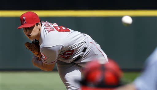 Los Angeles Angels starting pitcher Jason Vargas throws against the Seattle Mariners in the third inning of a baseball game Sunday, April 28, 2013, in Seattle, Wash. (AP Photo/Elaine Thompson)