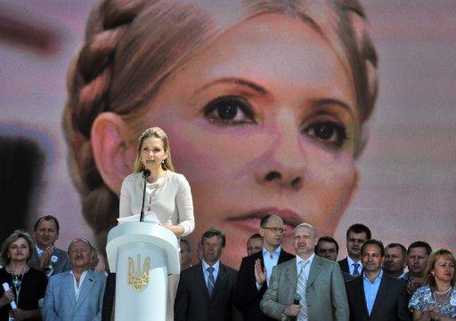 Yulia Tymoshenko's image is displayed as her daughter speaks at a rally in Kiev