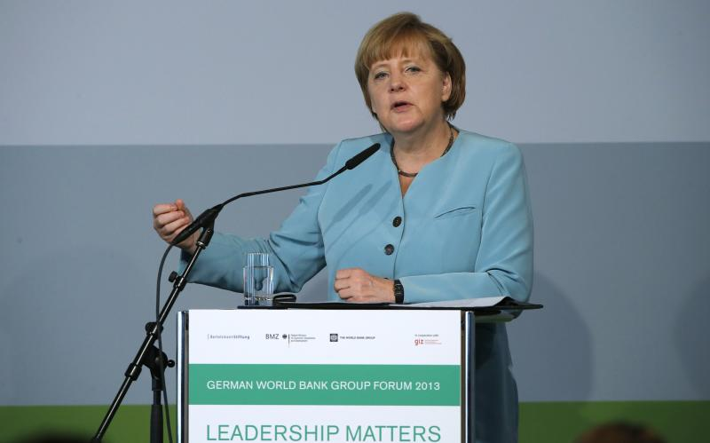 German Chancellor Angela Merkel makes a point during her speech at the German World Bank Group Forum 2013, in Berlin Thursday June 20, 2013. (AP Photo/Tobias Schwarz,Pool)