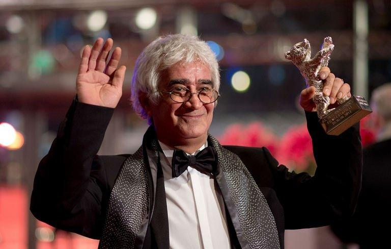 """Iranian director Kamboziya Partovi shows his Silver Bear for Best Script after the awards ceremony of the 63rd Berlinale Film Festival on February 16, 2013 in Berlin. Partovi won the Silver Bear for Best Script for the film """"Parde"""" he codirected with Jafar Panahi"""