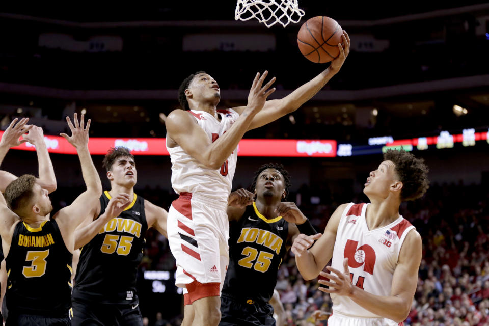 Nebraska's James Palmer Jr. (0) scores a basket with teammate Isaiah Roby (14), Iowa's Jordan Bohannon (3), Luka Garza (55) and Tyler Cook (25) watching during the second half of an NCAA college basketball game in Lincoln, Neb., Sunday, March 10, 2019. (AP Photo/Nati Harnik)