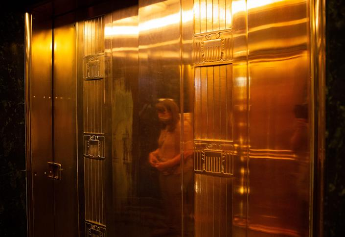 Patti Aaron, with the Bureau of Reclamation, is reflected in elevator doors, May 11, 2021, at Hoover Dam.