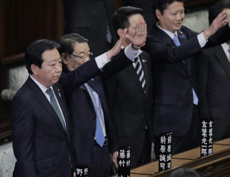 Prime Minister Yoshihiko Noda stands with Chief Cabinet Secretary Osamu Fujimura, second left, and Foreign Minister Koichiro Gemba, right, after he dissolved the lower house of parliament in Tokyo Friday, Nov. 16, 2012. Noda dissolved the lower house of parliament Friday, paving the way for elections in which his ruling party will likely give way to a weak coalition government divided over how to solve Japan's myriad problems. (AP Photo/Koji Sasahara)