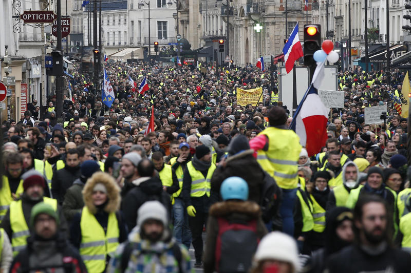 Yellow vest protesters demonstrate peacefully in the streets of Paris, France, Saturday, Jan. 12, 2019. Authorities deployed 80,000 security forces nationwide for a ninth straight weekend of anti-government protests. (AP Photo/Thibault Camus)