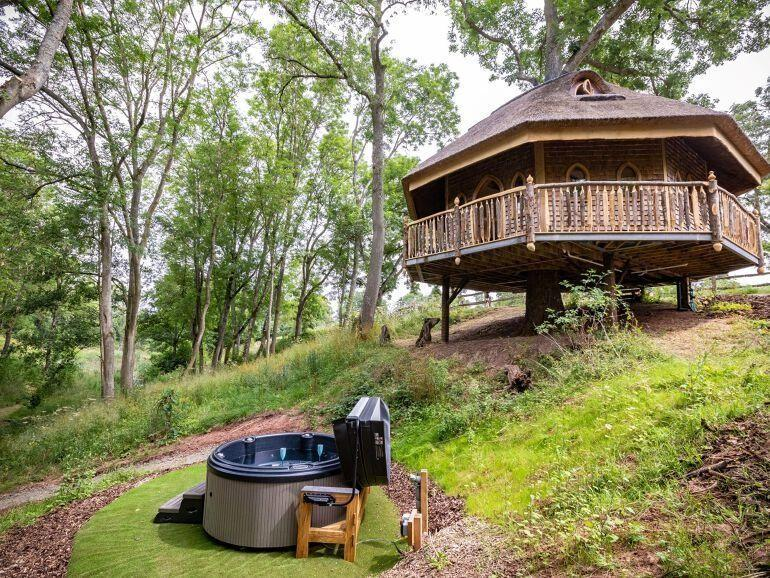 """<p><strong>Sleeps:</strong> 2</p><p>Set within the grounds of a working farm with lakes and meadows that you're free to roam, <a href=""""https://go.redirectingat.com?id=127X1599956&url=https%3A%2F%2Fwww.holidaycottages.co.uk%2Fcottage%2F63257-eathelin&sref=https%3A%2F%2Fwww.housebeautiful.com%2Fuk%2Flifestyle%2Fproperty%2Fg33931209%2Ftreehouse-holidays%2F"""" rel=""""nofollow noopener"""" target=""""_blank"""" data-ylk=""""slk:Eathelin"""" class=""""link rapid-noclick-resp"""">Eathelin</a> is a treehouse stay for two that offers all the romance. The stylishly quirky rental is built around a mature ash tree, featuring a king-size bedroom with a free-standing copper bath, a balcony surrounding the treehouse and access to a private hot tub and BBQ area. </p><p>Treehouse holidays costs from £673 for three nights with holidaycottages.co.uk<br></p><p><strong><a class=""""link rapid-noclick-resp"""" href=""""https://go.redirectingat.com?id=127X1599956&url=https%3A%2F%2Fwww.holidaycottages.co.uk%2Fcottage%2F63257-eathelin&sref=https%3A%2F%2Fwww.housebeautiful.com%2Fuk%2Flifestyle%2Fproperty%2Fg33931209%2Ftreehouse-holidays%2F"""" rel=""""nofollow noopener"""" target=""""_blank"""" data-ylk=""""slk:SEE INSIDE"""">SEE INSIDE</a><br></strong></p>"""