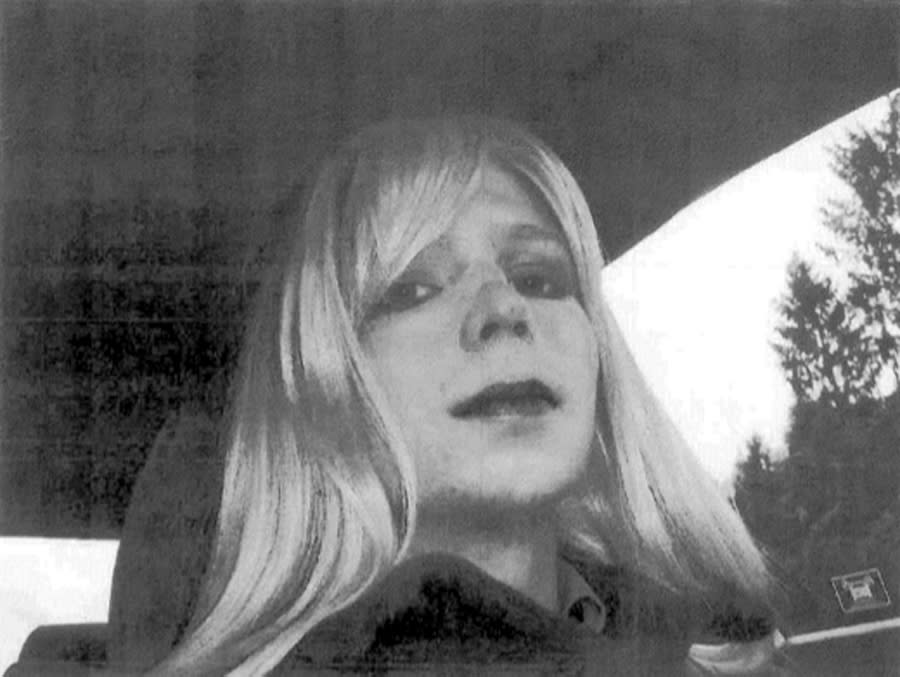 FILE - In this undated file photo provided by the U.S. Army, Pfc. Bradley Manning poses for a photo wearing a wig and lipstick. A northeast Kansas judge will make a final determination Wednesday, April 23, 2014, on Manning's request to change her name from Bradley Edward Manning to Chelsea Elizabeth Manning. Manning is serving a 35-year sentence for giving reams of classified U.S. government information to the anti-secrecy website WikiLeaks. (AP Photo/U.S. Army, File)