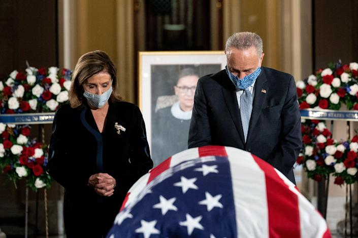 Chuck Schumer and Nancy Pelosi pay their respects to Ruth Bader Ginsburg at the US Capitol (REUTERS)