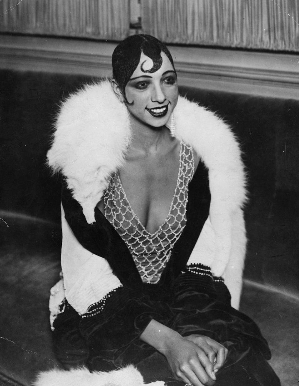 """<p>One of the most famous wearers of the Eton crop, Josephine Baker rocked her stunning slicked-down style with a """"kiss curl,"""" a thin swirl of hair on her forehead intended to add a touch of femininity.</p>"""