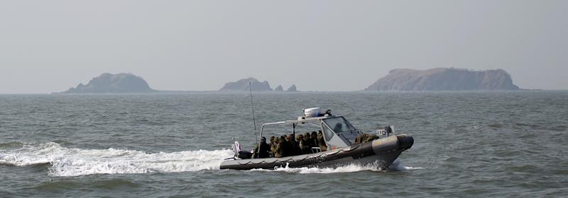 South Korean navy sailors in a speed boat patrol around South Korea's western Yeonpyong Island after finishing their exercise, near the disputed sea border with North Korea, South Korea, Monday, Feb. 20, 2012. South Korea on Monday conducted live-fire military drills from five islands near its disputed sea boundary with North Korea, despite Pyongyang's threat to attack. (AP Photo/Yonhap, Bae Jung-hyun) KOREA OUT