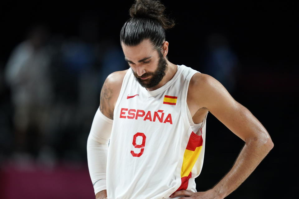 Spain's Ricky Rubio walks on the court at the end of a men's basketball preliminary round game against Slovenia at the 2020 Summer Olympics, Sunday, Aug. 1, 2021, in Saitama, Japan. (AP Photo/Charlie Neibergall)