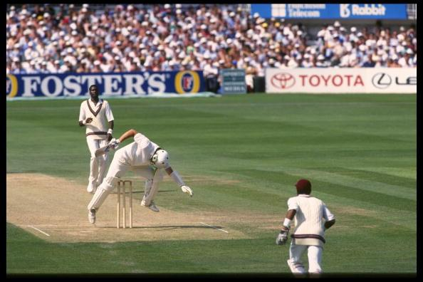 Aug 1991:  Ian Botham attempts to avoid a Curtly Ambrose bouncer but only succeeds in hitting his own wicket.  England v West Indies 5th Test at The Oval.                                     Mandatory Credit: Adrian Murrell/Allsport UK