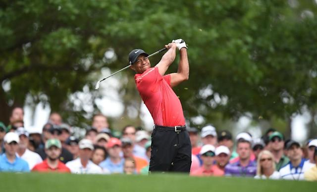 Tiger Woods of the US tees off on the 4th hole during Round 4 of the 79th Masters Golf Tournament at Augusta National Golf Club on April 12, 2015, in Augusta, Georgia (AFP Photo/Jim Watson)