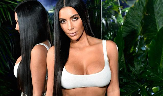"""Kim Kardashian, who is onto the trend that """"books are back."""" (Photo: Getty Images)"""