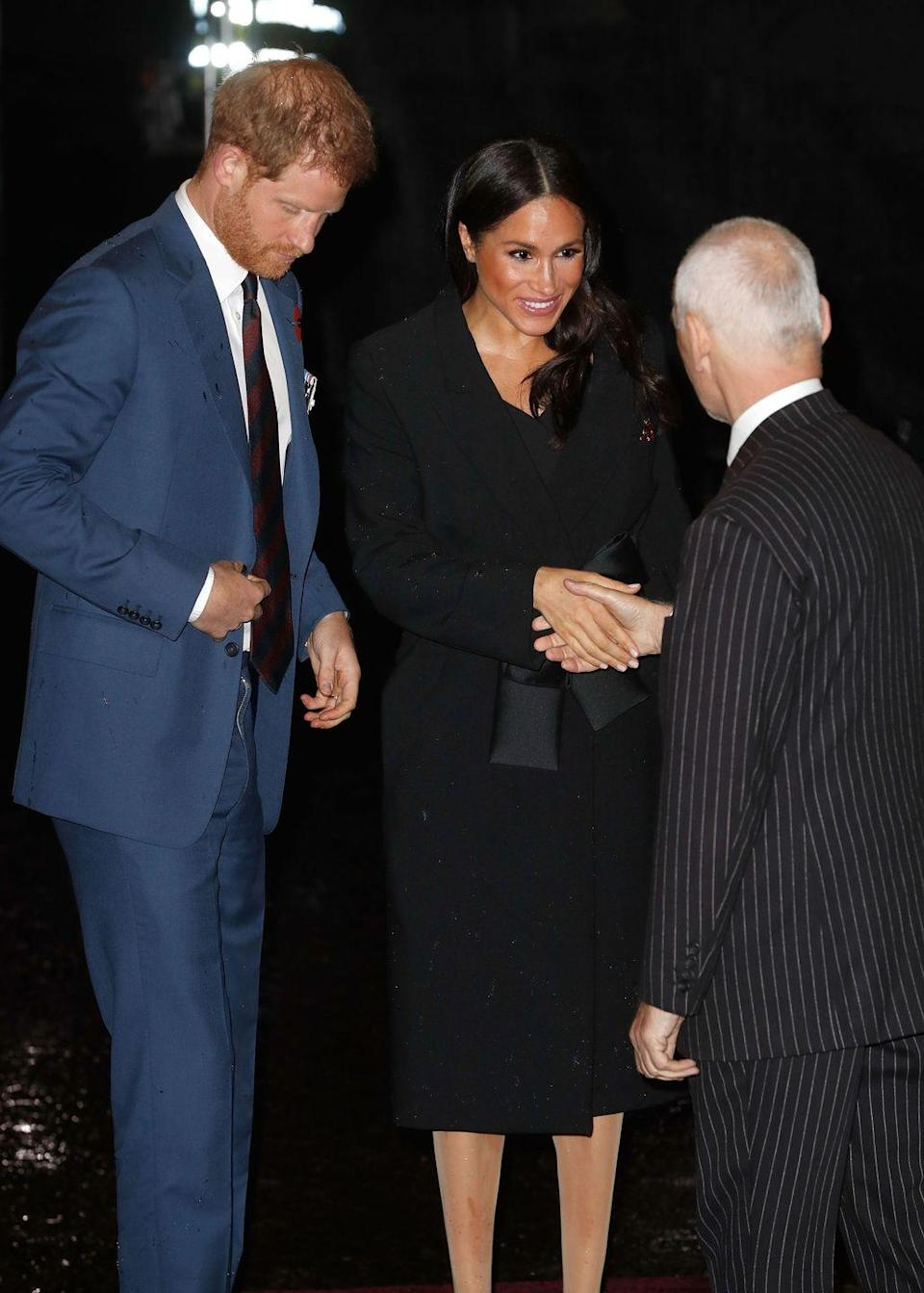 """<p>Meghan Markle sporting a <a href=""""https://www.net-a-porter.com/gb/en/Shop/Designers/Stella_McCartney"""" rel=""""nofollow noopener"""" target=""""_blank"""" data-ylk=""""slk:Stella McCartney"""" class=""""link rapid-noclick-resp"""">Stella McCartney</a> tie-detail coat (similar available here), over a black off-the-shoulder sheath dress by <a href=""""https://www.marksandspencer.com/double-crepe-bodycon-dress/p/p60214005?OmnitureRedirect=Double+Crepe+Bodycon+dress&source=affwindow&extid=af_a_Uncategorised_78888_Skimlinks&comgp=78888&cvosrc=affiliate.aw.78888&awc=1402_1542373349_f71aaa32f86cc1248315059389886495"""" rel=""""nofollow noopener"""" target=""""_blank"""" data-ylk=""""slk:M&S (which is only £49.50)"""" class=""""link rapid-noclick-resp"""">M&S (which is only £49.50)</a> to Royal Albert Hall on Saturday.</p><p>The event - which was the first Remembrance service attended by Markle since she joined the royal family earlier this year - saw the pregnant star team the look with a <a href=""""https://www.net-a-porter.com/gb/en/Shop/Designers/Stella_McCartney"""" rel=""""nofollow noopener"""" target=""""_blank"""" data-ylk=""""slk:Stella McCartney"""" class=""""link rapid-noclick-resp"""">Stella McCartney</a> shaggy deer faux leather crossbody bag, her favourite Manolo Blahnik black suede BB pumps, and earrings by Zofia Day<br></p>"""