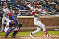 Philadelphia Phillies' Bryce Harper follows through on an RBI-double during the seventh inning of a baseball game against the New York Mets, Saturday, Sept. 18, 2021, in New York. (AP Photo/Mary Altaffer)