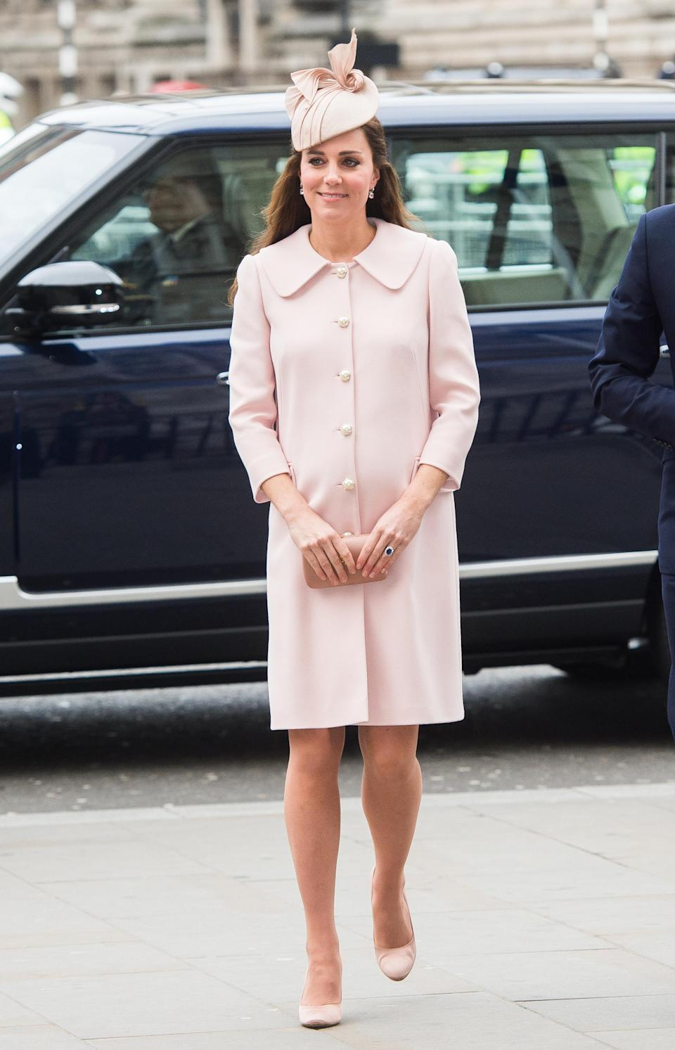 <p>Kate arrived at Westminster Abbey glowing in a pale pink Alexander McQueen coat and matching bow-adorned hat. (Photo: PA) </p>