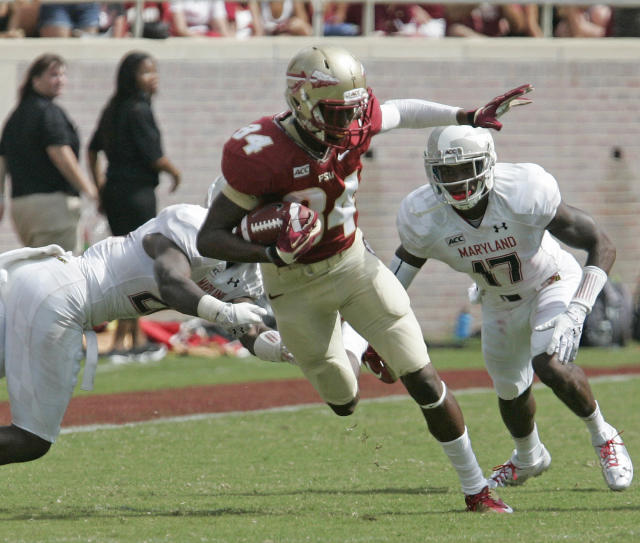 Florida State's Isaiah Jones tries to pick up extra yards after a reception against Maryland in the third quarter of an NCAA college football game on Saturday, Oct. 5, 2013, in Tallahassee, Fla. Florida State 63-0. (AP Photo/Steve Cannon)