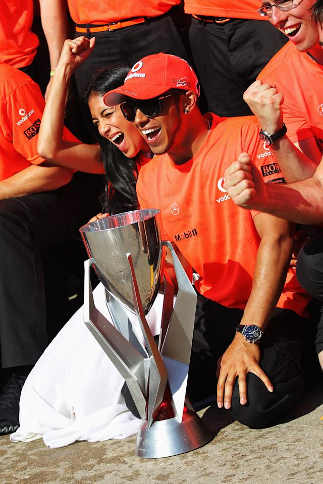 MONTREAL, CANADA - JUNE 10:  Lewis Hamilton of Great Britain and McLaren Mercedes celebrates with his girlfriend Nicole Scherzinger of the Pussycat Dolls after winning the Canadian Formula One Grand Prix at the Circuit Gilles Villeneuve on June 10, 2012 in Montreal, Canada.  (Photo by Mark Thompson/Getty Images)