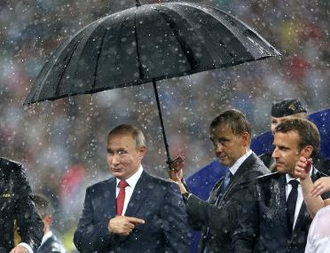 FIFA World Cup 2018: Vladimir Putin and his big umbrella at the finals spark a deluge of Twitter memes