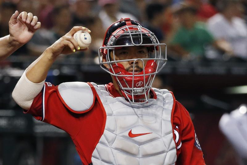 Washington Nationals catcher Kurt Suzuki gets a new baseball during the fifth inning of a baseball game against the Arizona Diamondbacks Saturday, Aug. 3, 2019, in Phoenix. (AP Photo/Ross D. Franklin)