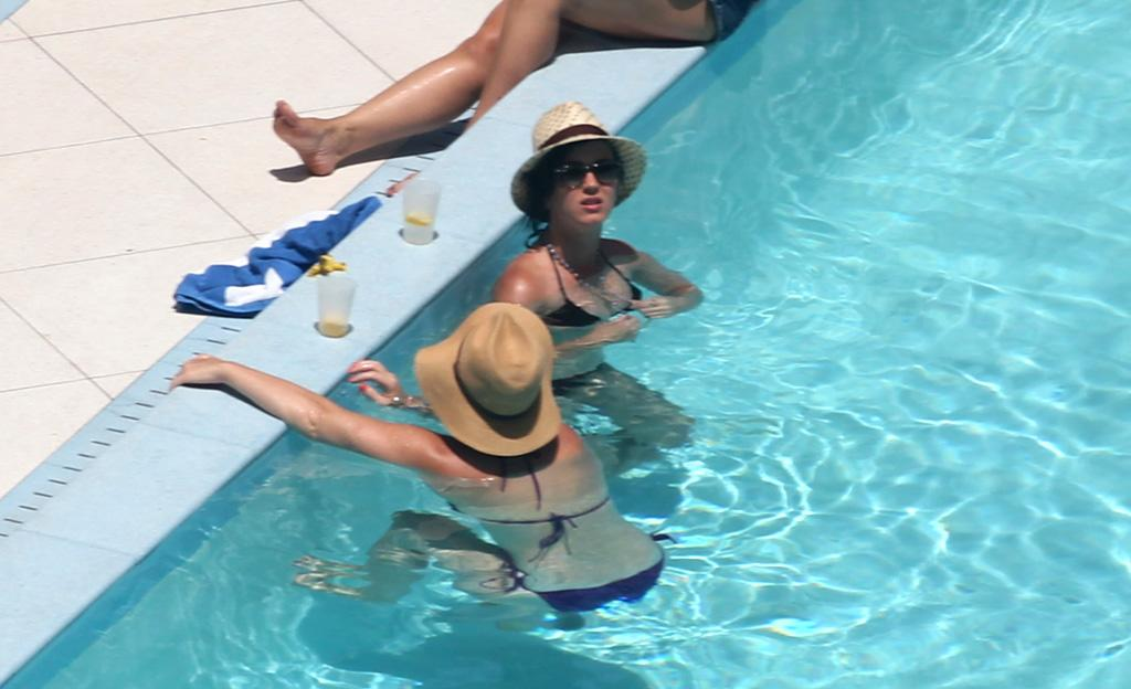 After selling her NYC pad on Friday and finalizing her divorce from funnyman Russell Brand earlier this month, Katy Perry took a much-needed break from the fast lane and hit  Miami with friends and family for a little fun in the sun. (7/27/2012)