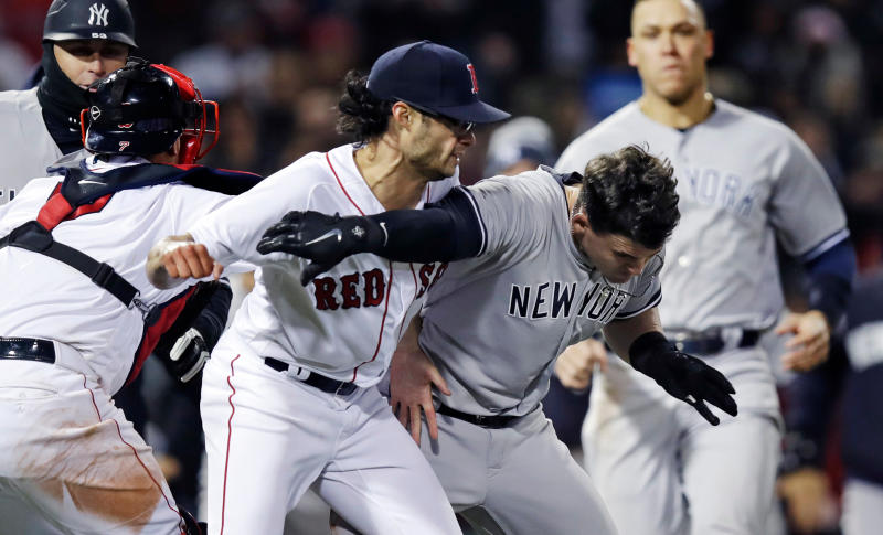 Boston Red Sox relief pitcher Joe Kelly (left) knocks down the Yankees' Tyler Austin as they fight during the seventh inning on Wednesday. (AP)
