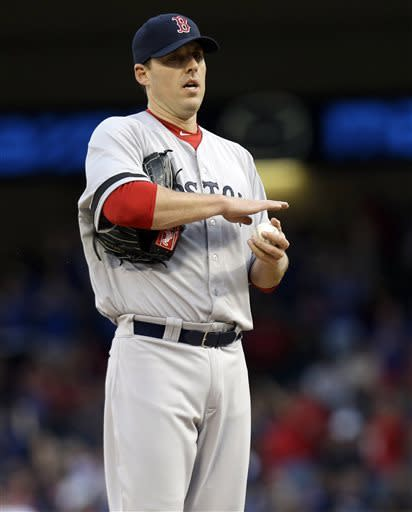 Boston Red Sox starting pitcher John Lackey (41) stands on the mound with a new game ball after giving up a solo home run to Texas Rangers' Ian Kinsler during the first inning of a baseball game Saturday, May 4, 2013, in Arlington, Texas. (AP Photo/LM Otero)
