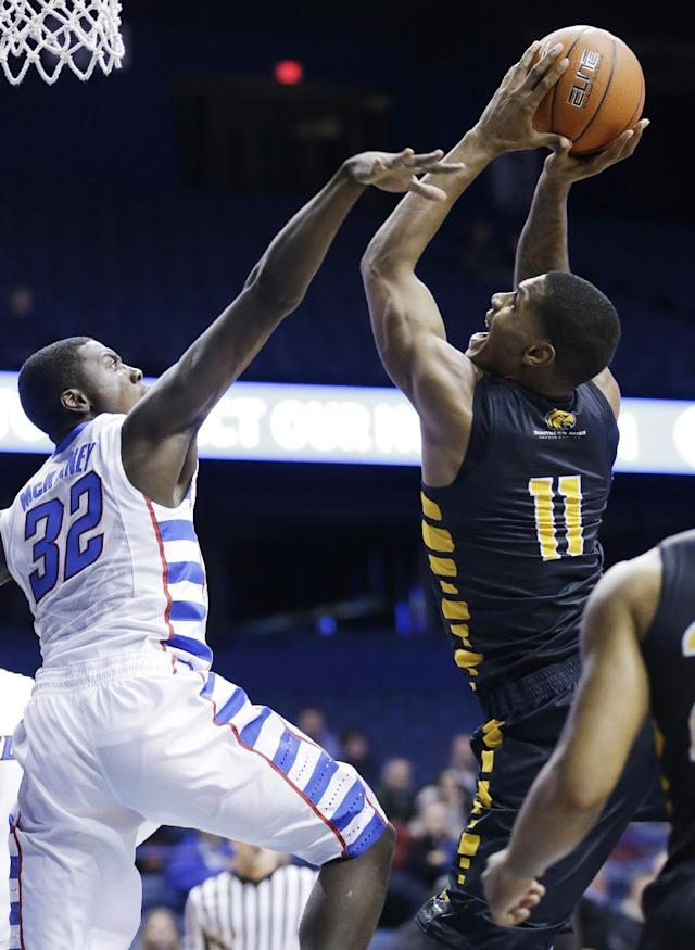 Southern Mississippi forward Daveon Boardingham, right, shoots over DePaul guard Charles McKinney during the first half of an NCAA college basketball game in Rosemont, Ill., Wednesday, Nov. 13, 2013. (AP Photo/Nam Y. Huh)