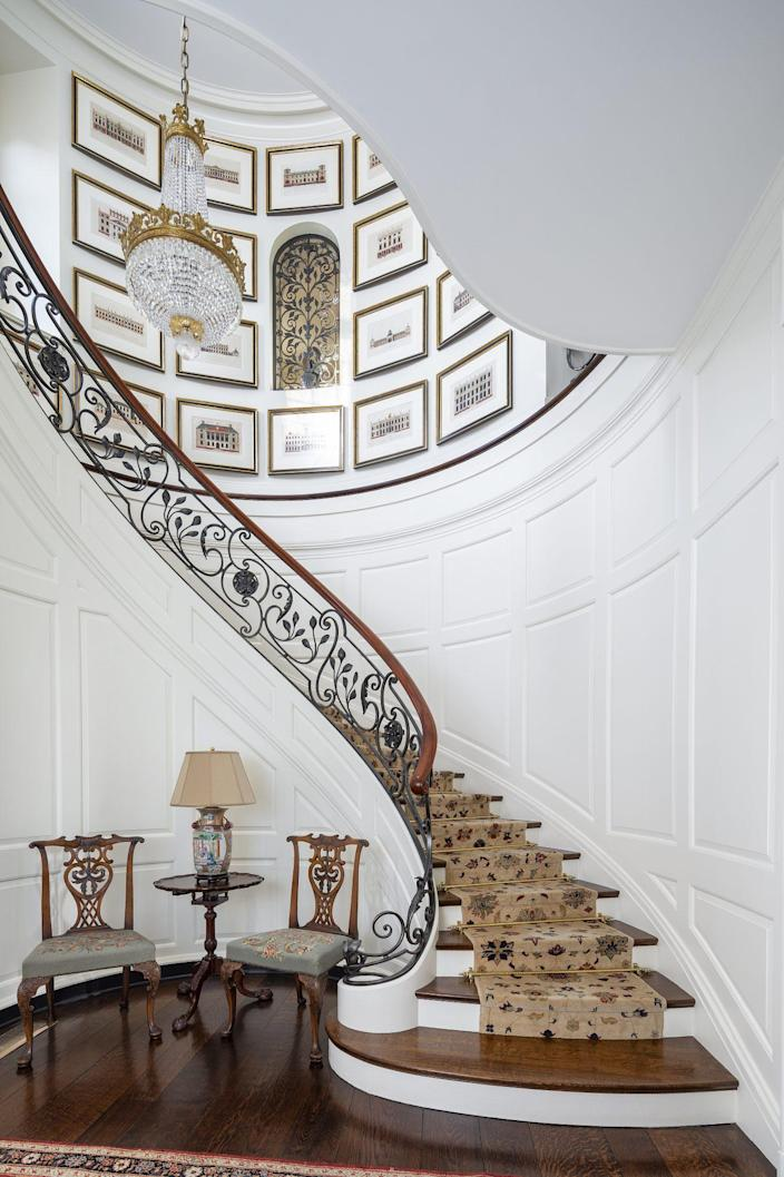 We love architect Lindeberg's signature circular staircase with wrought iron railings.