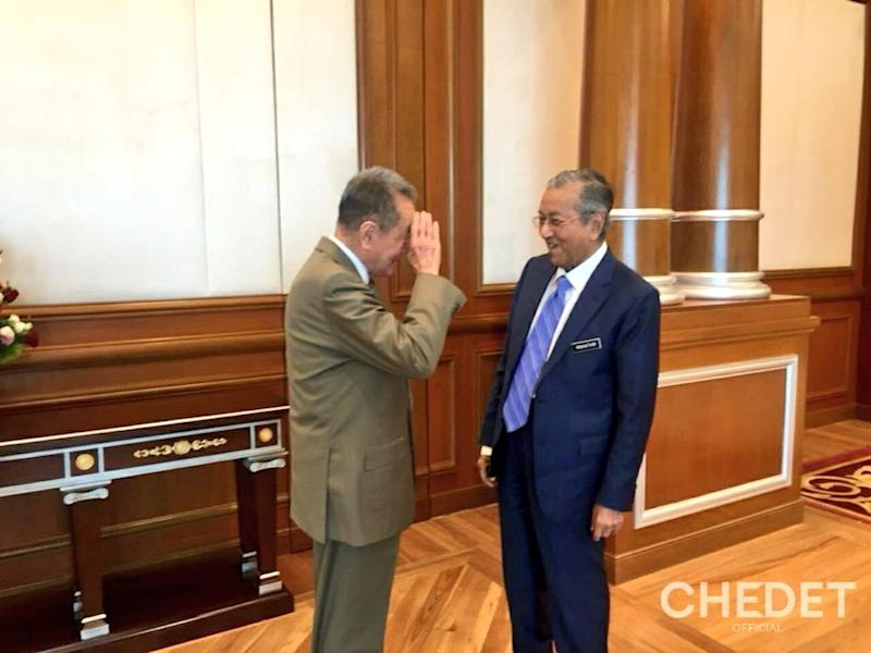 The tycoon salutes the PM at his office in Perdana Putra. — Picture via Twitter/ChedetOfficial