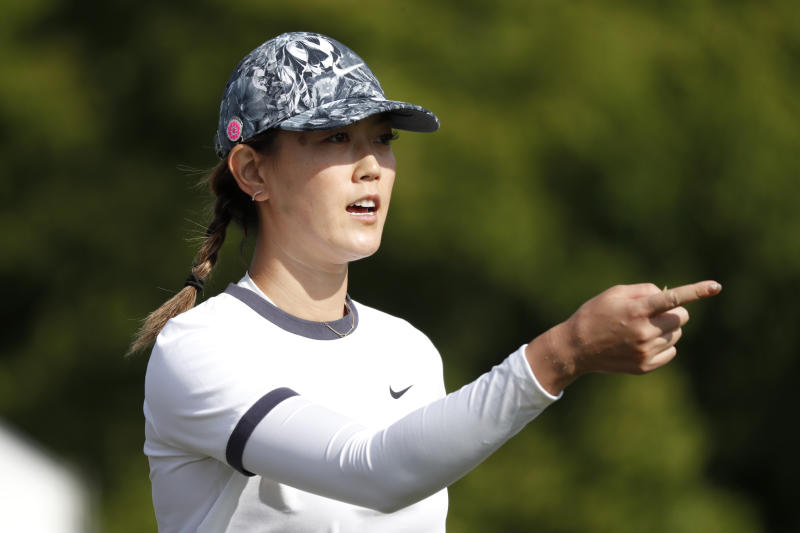 Michelle Wie gestures after her tee shot on the 10th hole during the first round of the KPMG Women's PGA Championship golf tournament, Thursday, June 20, 2019, in Chaska, Minn. (AP Photo/Charlie Neibergall)