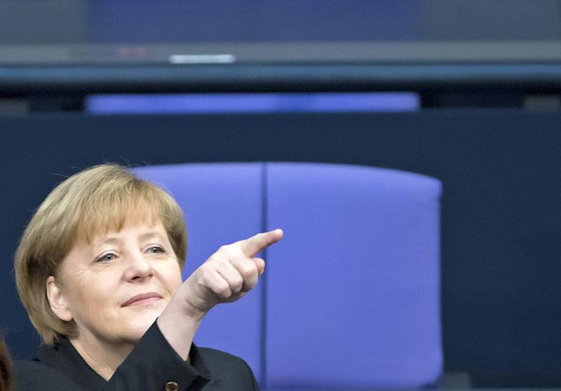 German Chancellor Angela Merkel gestures during the Chancellor election at a meeting of the German federal parliament, Bundestag, in Berlin, Germany, Tuesday, Dec. 17, 2013. (AP Photo/Jens Meyer)