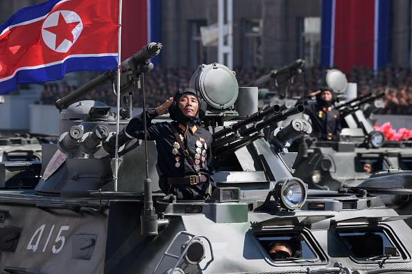 Korean People's Army (KPA) soldiers stand atop armoured vehicles during a military parade on Kim Il Sung square in Pyongyang.