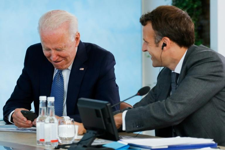 US President Joe Biden and French President Emmanuel Macron speak during a G7 summit in Carbis Bay, Cornwall, England on June 13, 2021 as the new US leader revives ties with allies