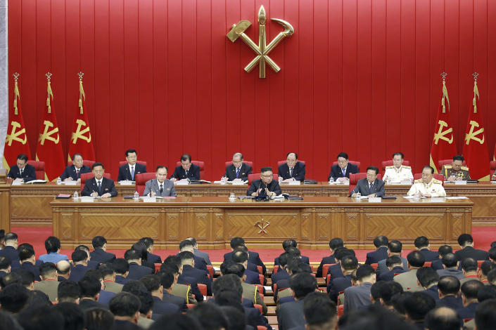 In this photo provided by the North Korean government, North Korean leader Kim Jong Un, center, speaks during a Workers' Party meeting in Pyongyang, North Korea, Tuesday, June 15, 2021. Kim warned about possible food shortages and called for his people to brace for extended COVID-19 restrictions as he opened a major political conference to discuss national efforts to salvage a broken economy. the North's official Korean Central News Agency said Wednesday, June 16, 2021. Independent journalists were not given access to cover the event depicted in this image distributed by the North Korean government. The content of this image is as provided and cannot be independently verified. (Korean Central News Agency/Korea News Service via AP)