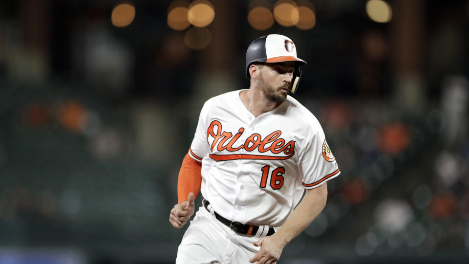 Baltimore Orioles' Trey Mancini takes third base on a wild pitch by Toronto Blue Jays starting pitcher Anthony Kay during the third inning of a baseball game, Thursday, Sept. 19, 2019, in Baltimore. (AP Photo/Julio Cortez)