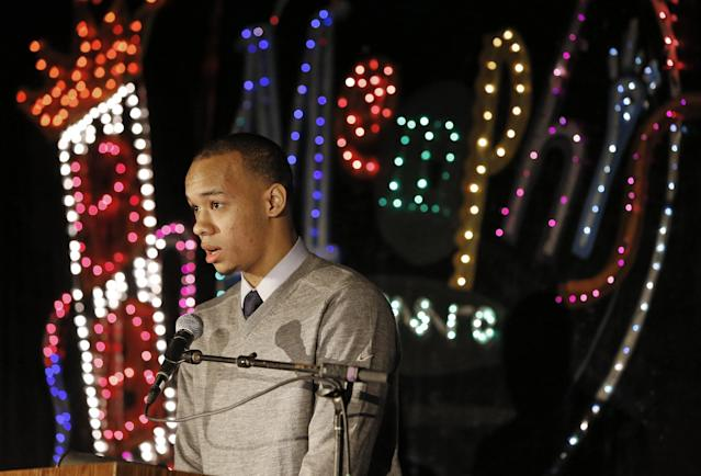 Connecticut guard Shabazz Napier accepts the award for American Athletic Conference player of the year, Wednesday, March 12, 2014, in Memphis, Tenn. (AP Photo/Mark Humphrey)