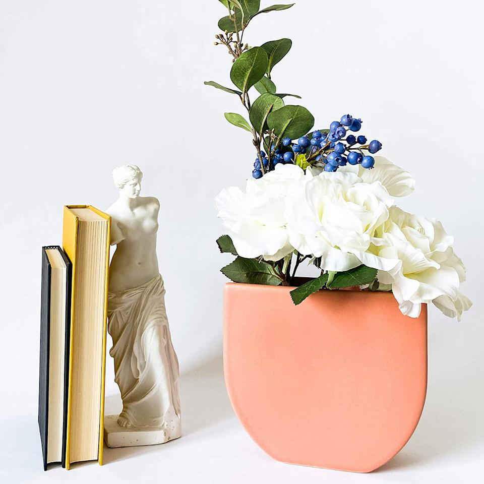 """<br><br><strong>Rhapsody Studio</strong> Ceramic Vases, Half Round, $, available at <a href=""""https://amzn.to/2Tr1aGN"""" rel=""""nofollow noopener"""" target=""""_blank"""" data-ylk=""""slk:Amazon"""" class=""""link rapid-noclick-resp"""">Amazon</a>"""