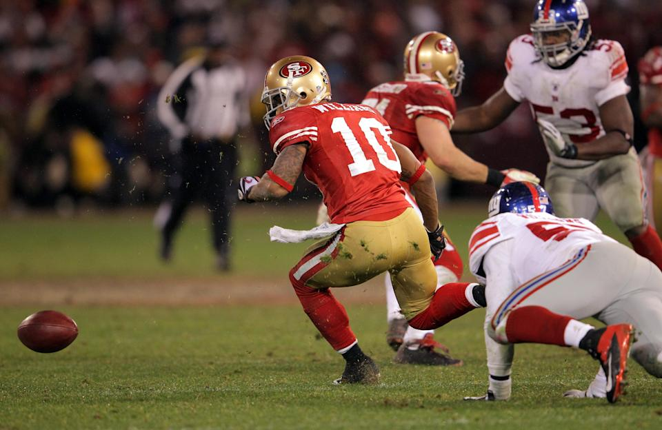 Kyle Williams fumbles the ball on a punt return in overtime against the New York Giants during the 2012 NFC championship game. (Getty)