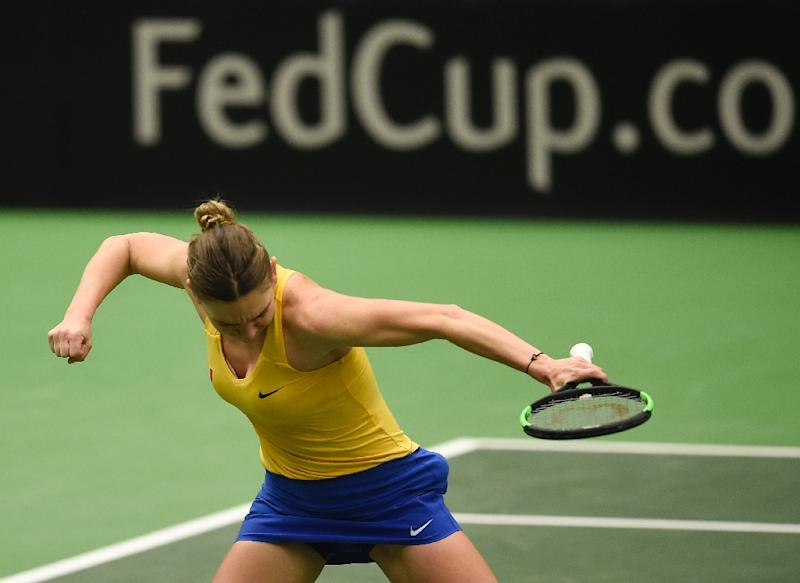 Romania beat title holders Czech Republic to reach Fed Cup semifinals