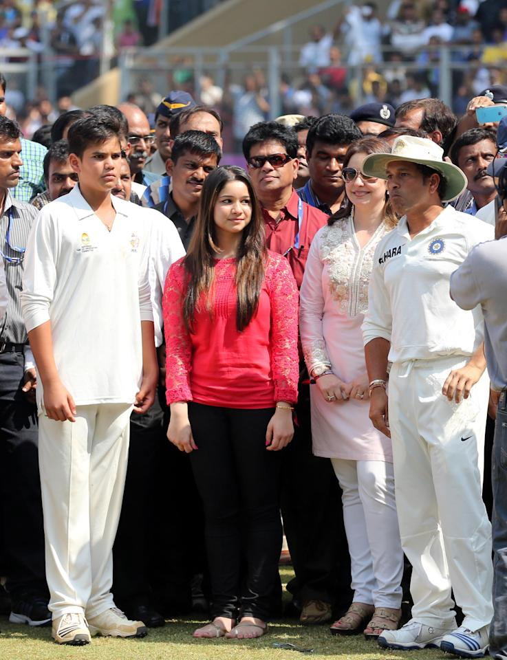 Cricket legend Sachin Tendulkar with his wife Anjali, daughter Sara and son Arjun during the presentation ceremony as the legend bid adieu to international cricket at Wankhede stadium in Mumbai on Nov.16, 2013. (Photo: IANS)