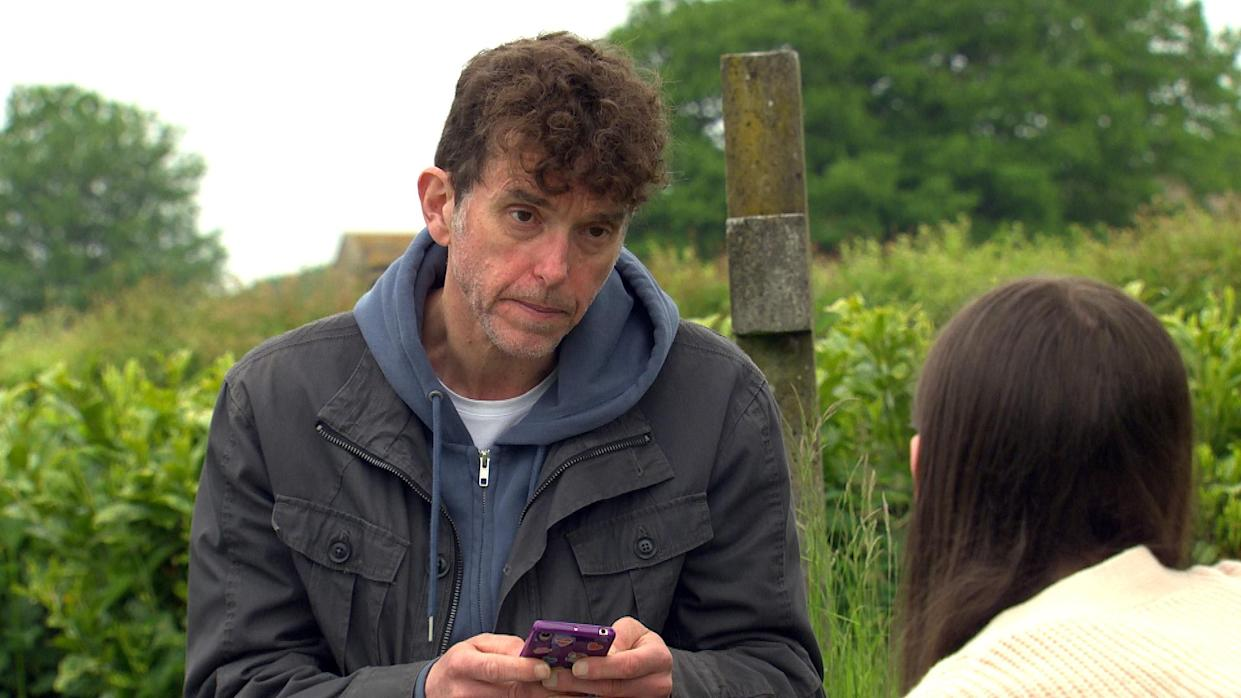 FROM ITV  STRICT EMBARGO  Print media - No Use Before Tuesday 20th July 2021 Online Media - No Use Before Tuesday 20th July 2021  Emmerdale - Ep 9110  Tuesday 27th July 2021   Intent on ridding April Windsor [AMELIA FLANAGHAN] of the bullies once and for all, Marlon Dingle [MARK CHARNOCK] takes her phone and deletes all her social media accounts.     Picture contact David.crook@itv.com   This photograph is (C) ITV Plc and can only be reproduced for editorial purposes directly in connection with the programme or event mentioned above, or ITV plc. Once made available by ITV plc Picture Desk, this photograph can be reproduced once only up until the transmission [TX] date and no reproduction fee will be charged. Any subsequent usage may incur a fee. This photograph must not be manipulated [excluding basic cropping] in a manner which alters the visual appearance of the person photographed deemed detrimental or inappropriate by ITV plc Picture Desk. This photograph must not be syndicated to any other company, publication or website, or permanently archived, without the express written permission of ITV Picture Desk. Full Terms and conditions are available on  www.itv.com/presscentre/itvpictures/terms