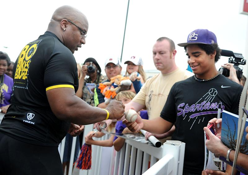Bo Jackson greets fans and signed autographs in Pleasant Grove, Ala., Friday, April 27, 2012,, on the fourth day of the Bo Bikes Bama charity bike ride on the one-year anniversary of the deadly Alabama tornadoes. Jackson and about 140 bicyclists and the celebrity bikers rode from Cordova, Ala. to Bessemer, Ala. on Friday. (AP Photo/The News, Linda Stelter) MAGS OUT